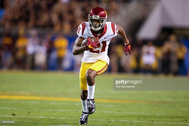 News Photo : Tyler Vaughns of the USC Trojans runs for a touch...