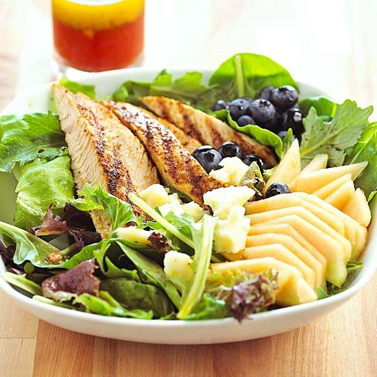 Juicy cantaloupe, ripe blueberries, and mixed greens add a burst of garden-fresh flavor to your dinner table.