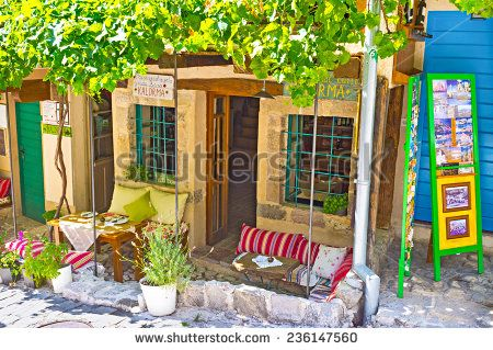 STARI BAR, MONTENEGRO - JULY 14, 2014: The tiny cafe with the nice terrace for the pleasant dinner, on July 14 in Stari Bar.
