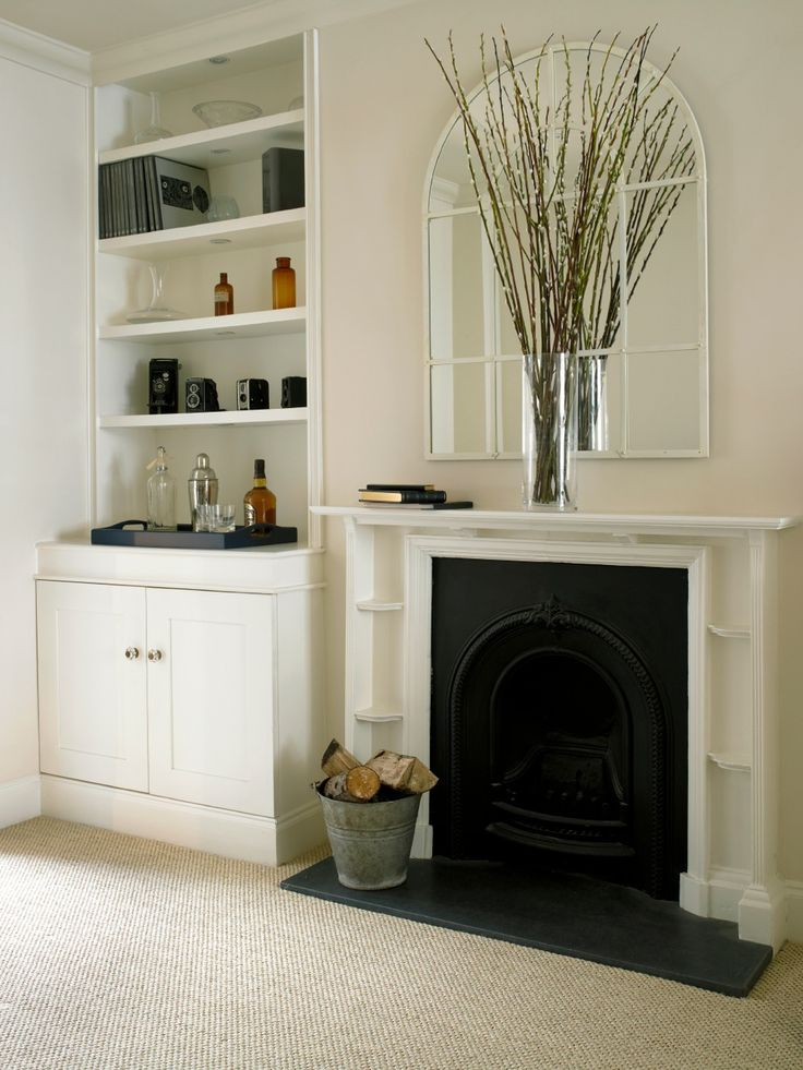 Victorian fireplace and fitted joinery. Slightly contrasting shelves and wall colours