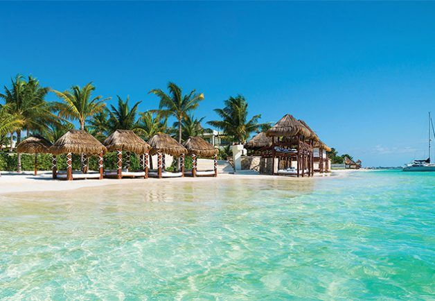 Azul Beach, Puerto Morelos, Riviera Maya, Mexico -  The clear, aquamarine water and powder-soft beaches of Mexico's Riviera Maya set the scene for the Karisma group's breezy and intimate Azul Beach. Both sophisticated and kid friendly, this all-inclusive has both the class and amenities to make its moderate rates feel like an incredible value. With a tequila lounge, stylish, modern accommodations, three attractive pools and a lovely expanse of beach equipped with comfortable cabanas, you…