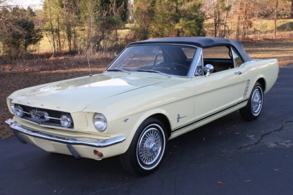 65' Ford Mustang... has to be yellow and convertible