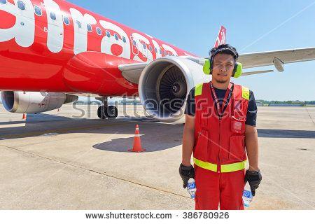 PATTAYA, THAILAND - FEBRUARY 26, 2016: ground crew member at U-Tapao International Airport. U-Tapao Rayong-Pattaya International Airport is serving Rayong and Pattaya cities in Thailand.