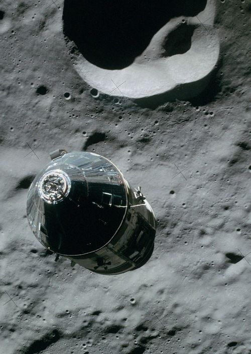 || Apollo 16 orbiting the moon... Love the very smooth , almost looks carved crater!