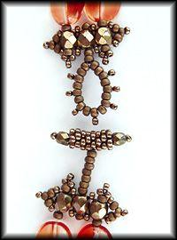 Kronleuchterjuwelen Glasperlenschmuck - Collier aus roten Glaslinsen (Detailfotos)