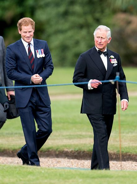 (R) Prince Charles, Prince of Wales and his youngest son Prince Harry attend the Gurkha 200 pageant at Royal Hospital Chelsea on June 9, 2015 in London, England.