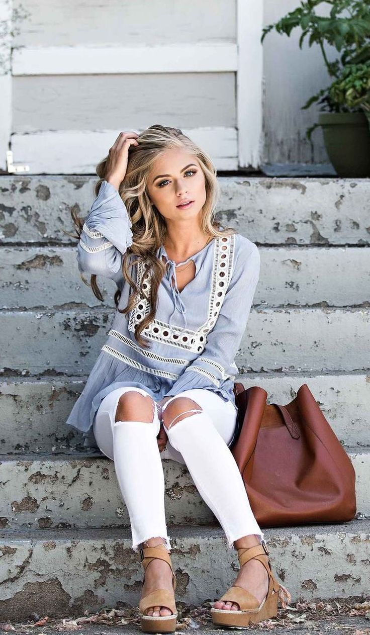 blue baby doll top with ripped white skinnies and nude wedges. ADORB