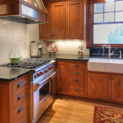 Cherry craftsman style cabinets soapstone counter tops for Farm style kitchen handles