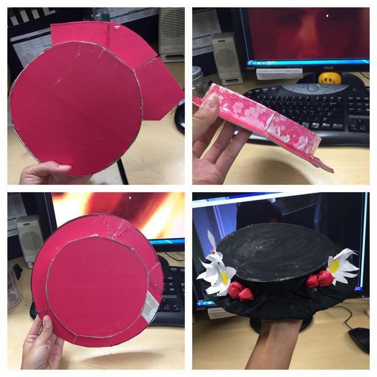 DIY Mary Poppins Hat.  -Shoe box  - Hot glue gun  -Black fabric  -Paper -Modge Podge
