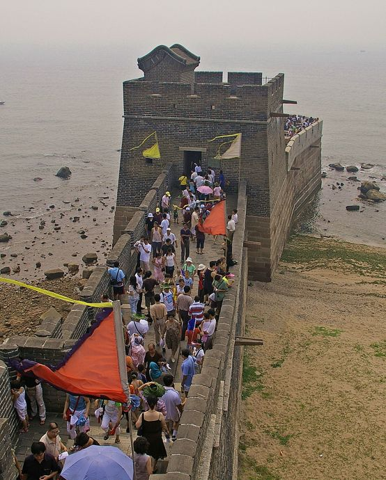 The beginning of the Great Wall of China. The eastern end of the wall starts at the Bohai Sea at Laolongtou (Old Dragon's Head) in Hubei Province near Qinhuangdao.
