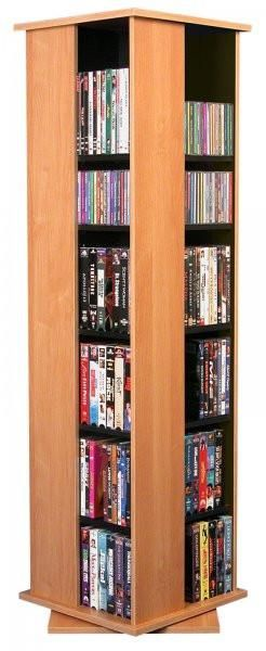 """612 Revolving CD Rack (Oak) (56"""" h x 16"""" w x 16""""d). These 4-sided beauties will brighten up any room. Because they rotate a full 360 degreesyou will never have to strain your neck locating your favorite CD, DVD, Video or Cassette. Nearly all the shelves are adjustable so even odd sized media like Disney Tapes can be accommodated. Constructed from durable melamine laminated particle board, these towers are stain resistant and easy to clean. Available in Cherry, Oak, and Black finishes...."""