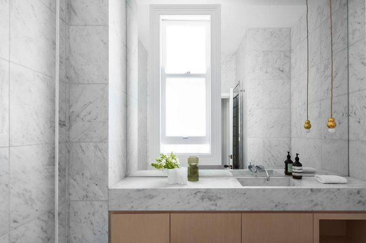 Sydney terrace house renovation given the luxury touch with bespoke cabinetry, chevron oak floo...