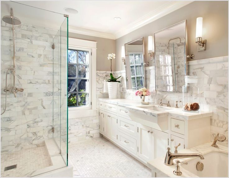 clean counter faucet flush inset cabinet frameless shower enclosure gray walls honed marble marble tub deck mirrors monochromatic