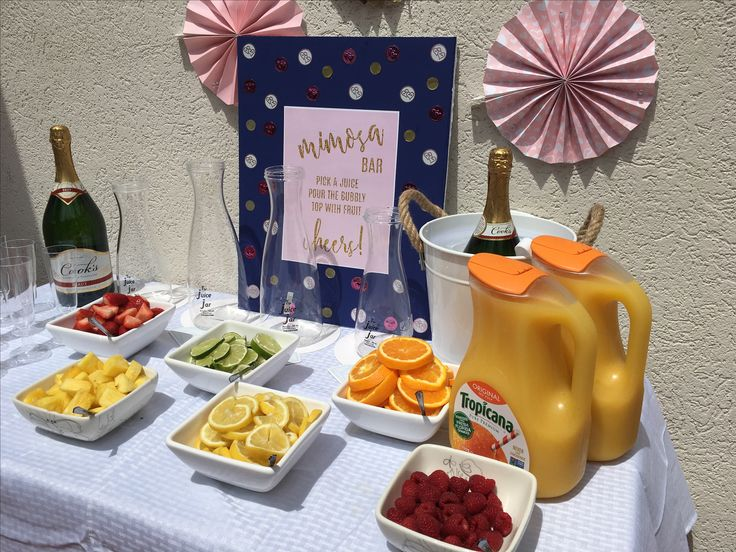 Provide OJ, champagne, and lots of different fruits for a make your own mimosa bar! #mimosa #champagne #mimosabar #bridalshower