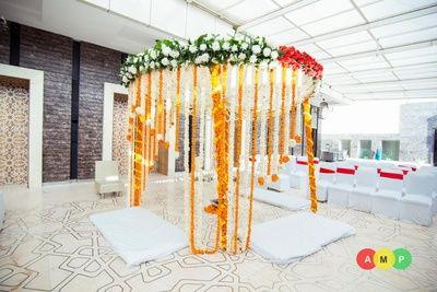 orange and white mandap, floral mandap decor, green and white flowers