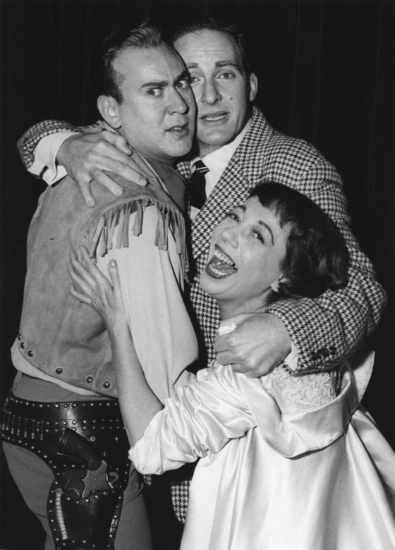 "Triple comedy team of Carl Reiner, Sid Caesar and Imogene Coca  New York: Triple comedy team (left to right) Carl Reiner, Sid Caesar, and Imogene Coca, embrace in the final fade-out scene of the premiere performance of their new half-hour series ""Sid Caesar Invites You"" on ABC-TV Sunday night January 26, 1958. The TV comedy trio is back together again after a three-year separation. (UPI Photo/Files)"