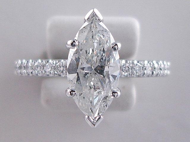 Beautiful 1.80 ctw Marquise Cut Diamond Engagement Ring with a 1.56 Marquise Cut H Color/SI2 Clarity Enhanced Center Diamond by BigDiamondsUSAcom on Etsy https://www.etsy.com/listing/260188192/beautiful-180-ctw-marquise-cut-diamond