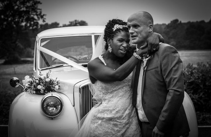 Bride & Groom with the wedding car.Wedding photography for Abe & Marsha who got married at Oakley House Bromley June 2016