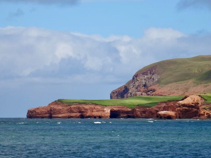 Red rocks, green grass and deep-blue sea in the Magdalen islands