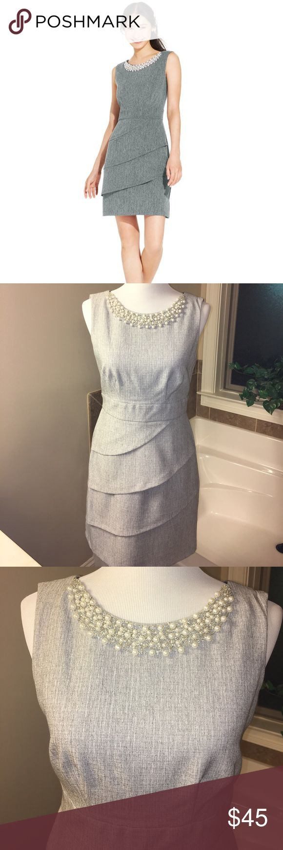 NWOT Connected Petite lt grey dress w pearl neck Pearlescent beading adds a classic vibe to this cute cocktail dress. Tiered asymmetrical skirt and sleek silhouette.  Zip back.  Never worn. Connected Petite Dresses