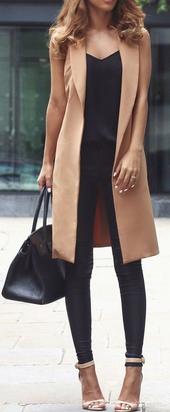 love the camel colored vest with the neutral shoes... too pale to wear it though, i'd go grey or black