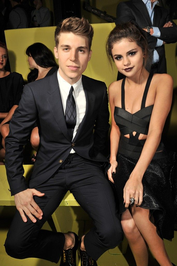 Nolan Funk and Selena Gomez Front Row at Versace [Photo by Stéphane Fèugere]