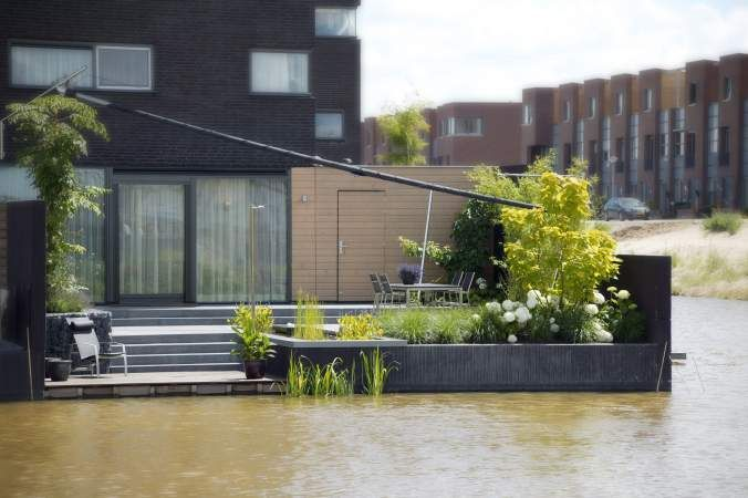Afbeeldingsresultaat voor kleine tuin aan water