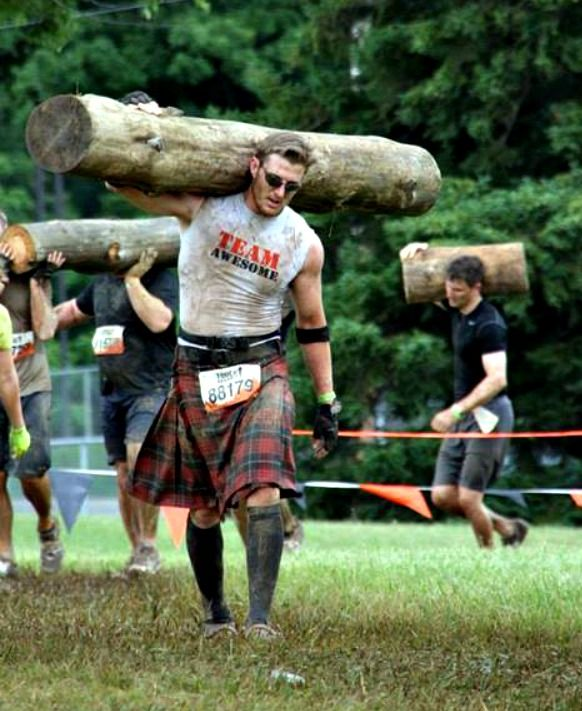 imma just carry this tree... like it aint no thing... in a kilt..... Andrea, I think this is where we're going to find your husband.