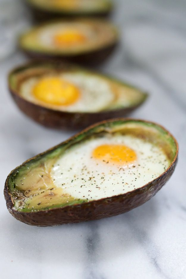 Baked Avocado Eggs// This quick and easy baked egg in an avocado recipe is perfect for breakfast or snacking. It's low in sugar and loaded with protein, healthy fats and fiber!