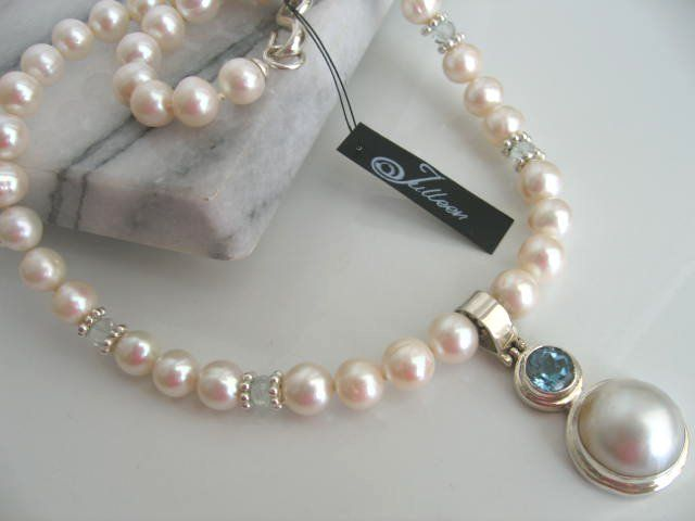 A touch of blue with a white pearl necklace