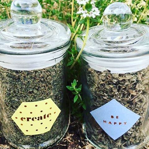 Dried herbs in a glass jar with an inspirational sticker. Great present idea