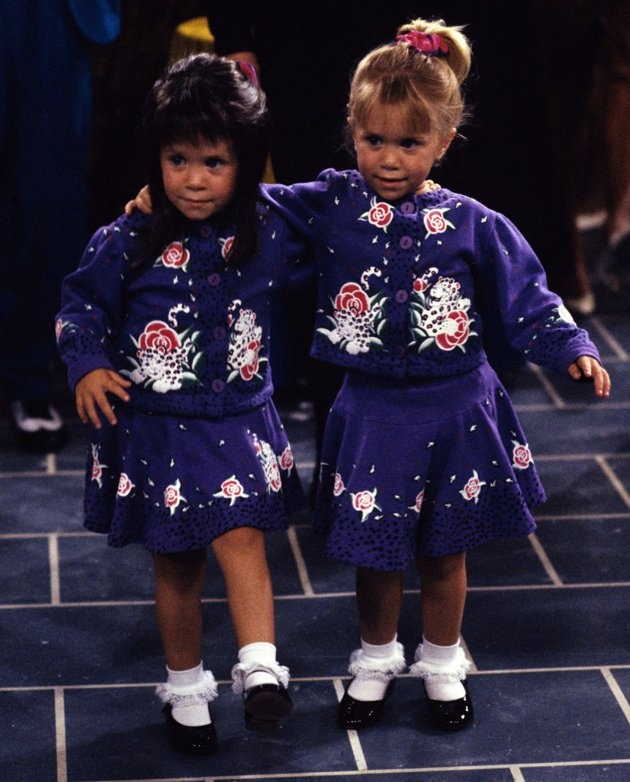"""During the run of """"Full House,"""" Mary-Kate and Ashley appeared onscreen together four times. Perhaps the most memorable instance was in the Season 4 episode """"Greek Week."""" In a Patty Duke-like twist, Mary-Kate took on the role of Melina Katsopolis, Michelle's look-alike cousin who was visiting from Greece."""