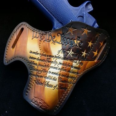 Custom Leather Holsters, wallets, and keychains. Savoy Leather