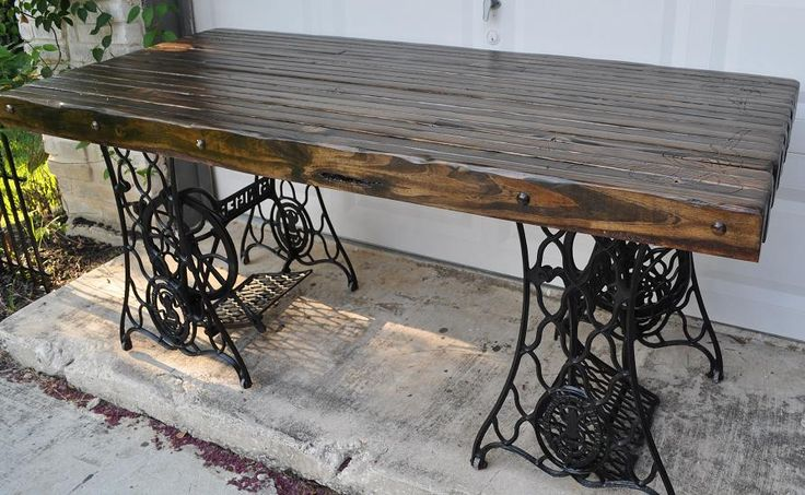 "Two old Singer sewing machine bases. For the top 2x4s put together, disressed, and stained to make a ""old"" farmhouse table. by ADN artistry"
