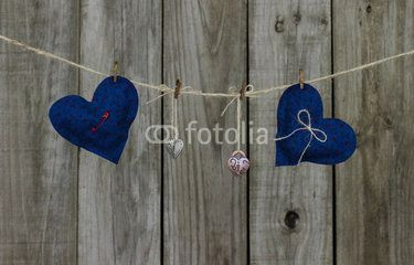 Blue country hearts and locks hanging on clothesline