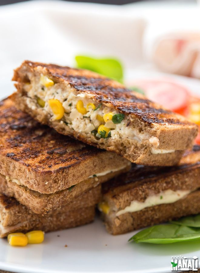 Grilled cheese sandwich packed with paneer (Indian cottage cheese) and sweet corn. Find the recipe on www.cookwithmanali.com