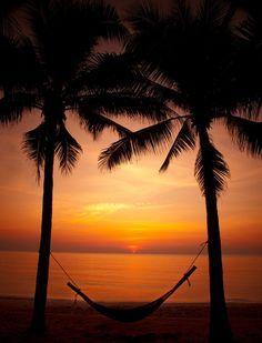 Relaxation at it's finest watching the deep beautiful #sunset at #Anantara Hua Hin Resort & Spa