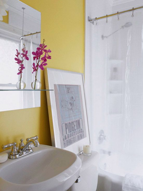 Key takeaways for working with a small bathroom:   bright colour can open up a tiny room, frameless mirror is very clean and unfussy, clear shower curtain opens up the space, and and a single piece of oversized art is a simple way to add visual interest.