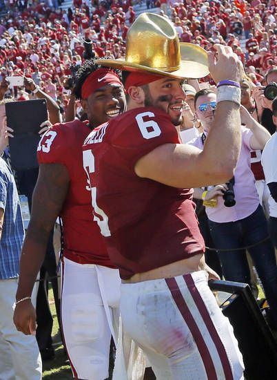 Oklahoma's Baker Mayfield (6) wears the Golden Hat next to Ahmad Thomas (13) after the Red River Showdown college football game between the University of Oklahoma Sooners (OU) and the Texas Longhorns (UT) at Cotton Bowl Stadium in Dallas, Saturday, Oct. 8, 2016. OU won 45-40. Photo by Nate Billings, The Oklahoman