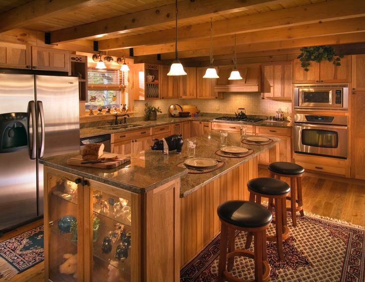 Pendant Lights And Stainless Appliances Highlight This Log Home Kitchen.
