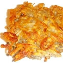 This is a traditional potato pancake recipe, and is a wonderful comfort food. Serve with applesauce and sour cream for a light dinner, or with roast chicken for a hearty winter meal. You can use more flour if the mixture seems too wet.