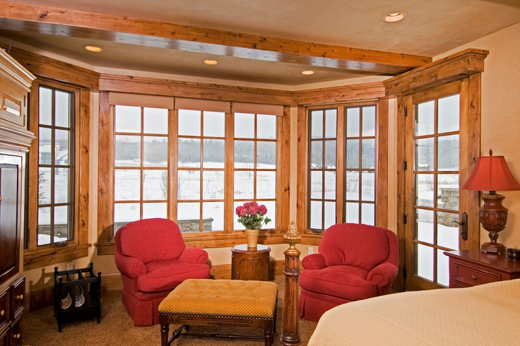 A bank of Pinnacle Casement windows provides a lovely view in this cozy sitting area. Windsor Windows & Doors. www.windsorwindows.com