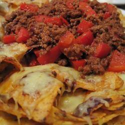 Nacho chili met kaas  (kan ook met half om half gehakt, als kaas is komijnekaas erg lekker en voor de koriander is peterselie ook goed omdat veel mensen niet van verse koriander houden)