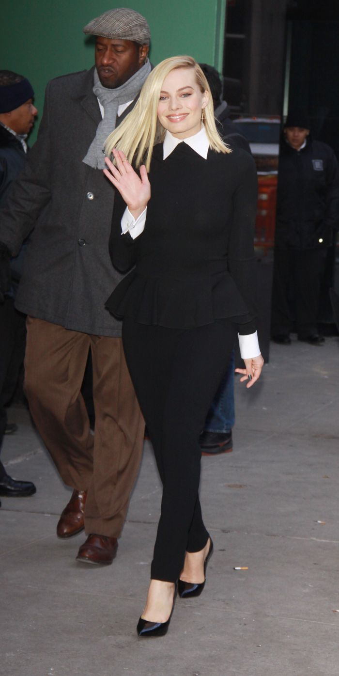 Australian actress Margot Robbie, the breakout star of The Wolf of Wall Street with Leonardo DiCaprio, wore the Ralph Lauren Collection Spring 2014 black knit jersey peplum top and black double-faced wool pant for an appearance on ABC's Good Morning America.