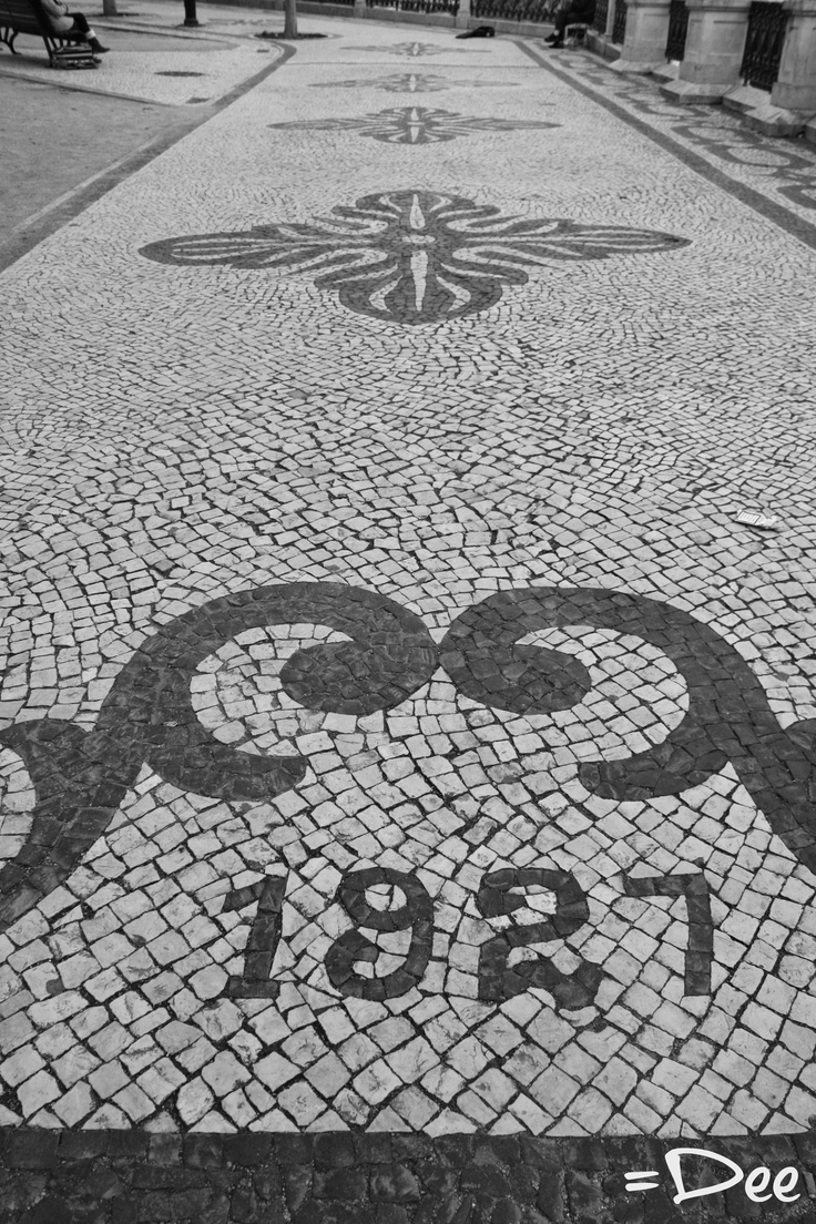 Beautiful cobble stone paving in the streets of Lisbon
