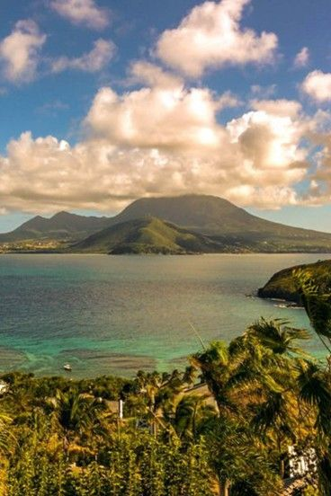 Our view of Nevis from our #housesitting assignment here on St. Kitts. Have you considered house sitting? Get inspired with these inspiring destinations to house sit this summer. Read more at http://wanderlusters.com/inspiring-destinations-to-house-sit-this-summer/ #travel #housesitting #wanderlust