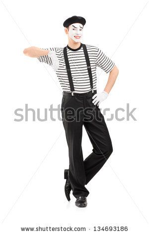 Full length portrait of a male mime artist posing isolated against white background - stock photo