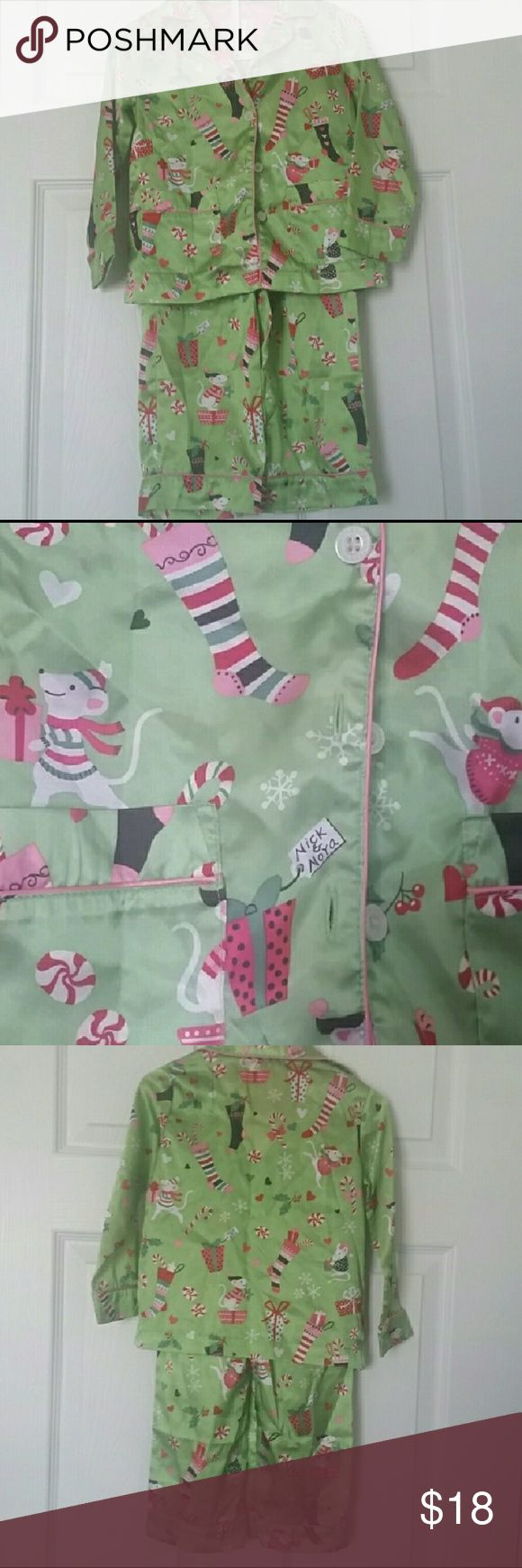 Christmas Pajamas Nick and Nora Adorable green and pink 2 piece Nick and Nora Christmas PJs. Stockings, peppermint, gifts...oh my!   The fabric is covered with sweet Christmas treats and mice characters.  Elastic waist pants and long sleeve button up top with pockets.  Satin feeling material and pink trim. Nick and Nora Pajamas Pajama Sets