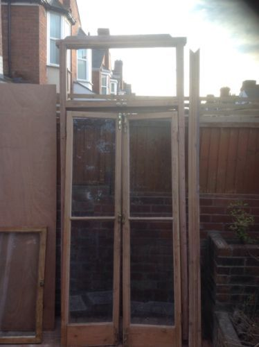 Reclaimed-Victorian-Edwardian-doors-with-panel-above-frame-brass-fixings