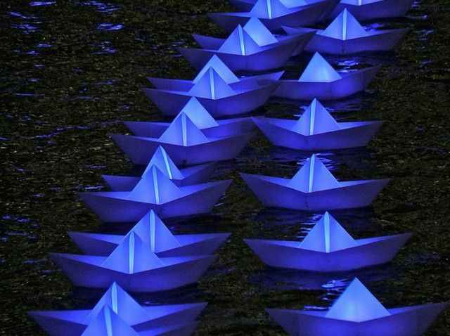 Aether & Hemera   Installation at London's Canary Wharf, presented until 15 February 2013. Called Voyage, this beautiful creation offers a fleet of 300 boats illuminated recalling the form of paper boats that can change colors.